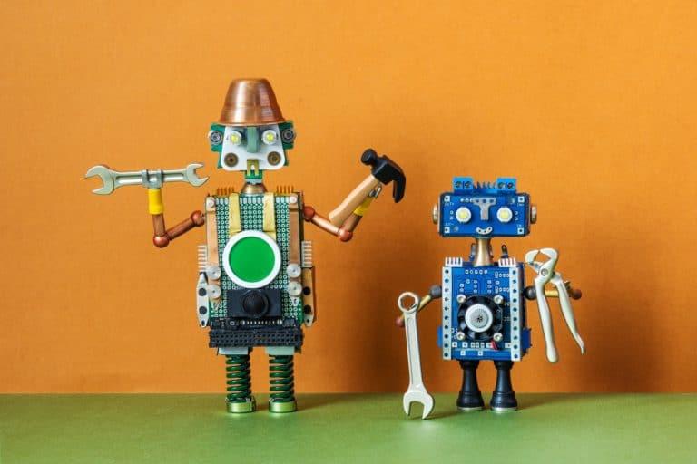 Robots service workers. Fixing maintenance robotics electronic diagnostics concept.